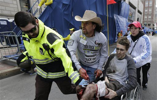 Carlos Arredondo had applied pressure to a man's leg wounds before medical help arrived.  (Photo by Charles Krupa/AP)